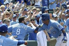 Kansas City Royals' Salvador Perez (13) does a home run routine with Mike Moustakas after Perez hit a go ahead solo home run in the eighth inning during Sunday's baseball game against the Texas Rangers on June 7, 2015 at Kauffman Stadium in Kansas City, Mo.