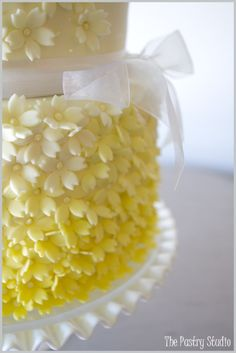 a closer look…  Yellow Ombré Cake with Sugar-Paste Blossoms by The Pastry Studio:Daytona Beach,Fl.  www.thepastrystudio.com