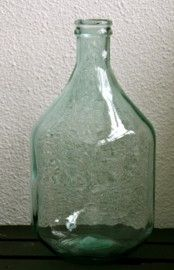 Green bottle of 100% recycled glass
