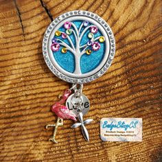 Flamingo charm. Blue Badge. Nurse badge. Just ordered and sent to Littleton, CO! I had to specially find, and paint the pink flamingo. It was originally all gold!
