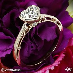 unique Custom Verragio 18k Rose Gold Engagement ring (ENG-0409) with a Bezel set Heart Diamond and heart shaped scrolls in the opening gallery under the cathedral arms. Set with a beautiful 1.05 J VS2 heart shaped Diamond