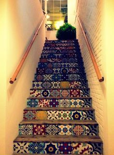 cant decide if i prefer patchwork or matching pattern tiles for the stairs...