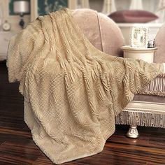 This herringbone brushed faux fur throw blanket is a beautifully soft and elegant throw that is made of super soft micro fiber fabric with an equally soft sherpa style backing. This throw is conveniently machine washable.