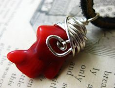 Red Coral Silver Wire Wrapped Black Leather Necklace Unisex for Men or Women Tribal Rocker Fashion. $25.00, via Etsy.