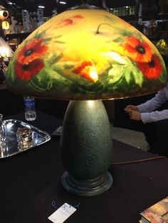 Jefferson Poppy Lamp~The lamp features eye popping red poppies~Dragonflies and bumblebees~Set on a glass base
