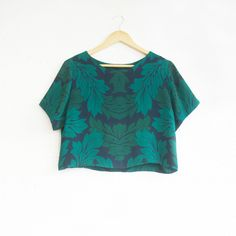 This T-Blouse is a cropped oversize shape featuring original engineered 'Ornamental Leaf' print from the Alter Native collection.Short sleeves, round scoop neck and relaxed cut.Made from digitally printed 100% silk double georgette.Dry clean or hand washable.Limited Edition. Made in Adelaide.* * * Sold Out