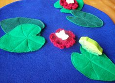 Reversible Felt Play Mat with INSIDE Storage - Bright blue pond, frog, lily pads, and lilies on one side and Pretty river on the back. $27.80, via Etsy.
