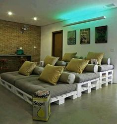 """DYI home movie theater with wood palettes--LOVE THIS!! Always wanted a """"home theater"""" and now I've found an affordable and unique way to do it!! Best part too is that we'd all be together!! <3"""