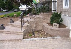 Exterior Bricks Outdoor Staircase Railing With Black Iron Design With Small Outdoor Home Garden Plant Design Also Contemporary Front Stoop And  Front Stoop Ideas for Your Home