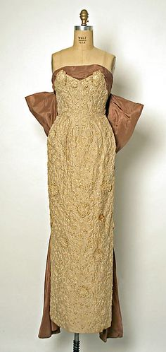 Evening dress Designer: Jean Dessès (French (born Egypt), Alexandria 1904–1970 Athens) Date: ca. 1953 Culture: French Medium: silk, cotton, plastic Dimensions: Length at CB (a): 45 in. (114.3 cm) Length at CB (b): 38 1/4 in. (97.2 cm) Credit Line: Gift of Karen F. Swensrud, in honor of Helen S. Fitkin, 1988