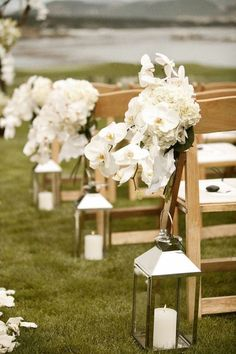 Do navy candles in the lanterns to match the guys' suits, emerald and burgundy/plum colored flowers instead of all white to match the rest of our wedding colors