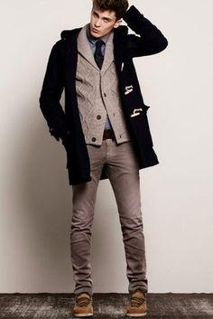 Men's Brown Suede Boots, Brown Jeans, Dark Brown Leather Belt, Blue Polka Dot Longsleeve Shirt, Black Tie, Grey Shawl Cardigan, and Navy Duffle Coat