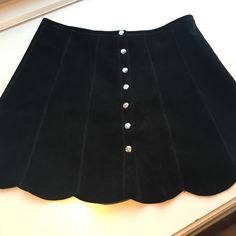 The Reformation black suede skirt Only worn once. Button front and scalloped hem. Reformation Skirts Mini