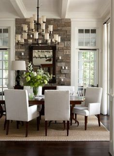 Open dining room with stone wall!