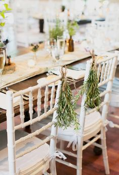 I like the idea of a bunch of plants or flowers to signify where the bride and groom sit