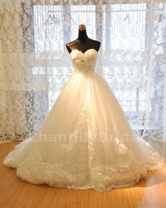Ball Gown Sweetheart-neck Strapless Chapel Train Satin and Tulle Wedding Dresses. $259.99, via Etsy.