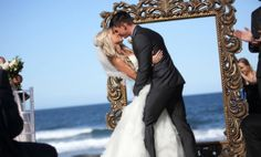 Beautiful bride and groom in front of our gold frame at Shelly Beach, Sunshine Coast, Qld, Australia  www.dreamweddingceremonies.com.au