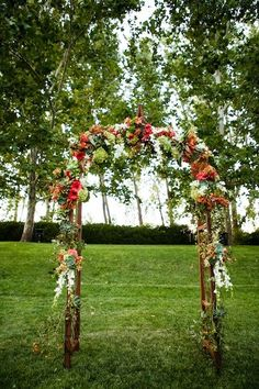 2014  corals and pinks with  lush green wedding arch decor, colorful floral wedding arch decor.