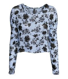 Short blue sweater with long sleeves, wrap-style back, and black floral print. | H&M Pastels