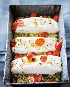 Halibut with Tomatoes and Leeks   Smothering fish fillets in summer's tomatoes and leeks creates an easy seasonal meal in one pan. If you like, cut fresh basil into thin slivers and use it to garnish the halibut.