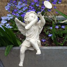 Sitting Cherub Blowing Horn (Left) - Garden Ornament Or Home