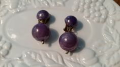 Check out this item in my Etsy shop https://www.etsy.com/listing/233536269/vintage-purple-bead-dangle-drop-earrings