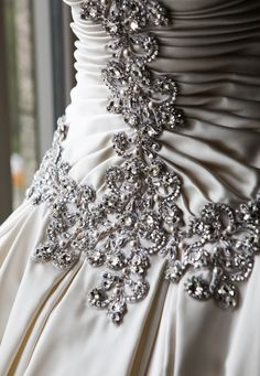 It's all in the details!  The #luxbride's traditional satin wedding gown featured crystals, pearls and platinum embroidery on the bodice. @Templars Events
