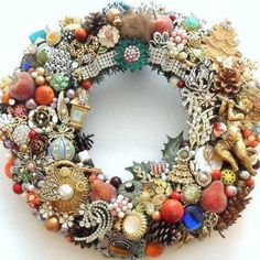 pinning a pin wreath. Nice way to use old jewelry