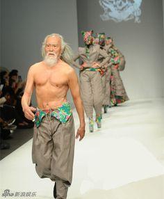 Wang Deshun, 79, presents a creation by Chinese designer Hu Sheguang for the Hu Sheguang 2015-2016 A/W Collection show during China Fashion Week in Beijing