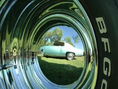 Aaron's reflection of his 1970 Monte Carlo first generation he lives in Canada