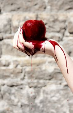 This is a bloody apple. The apple is a sign of temptation, suggesting the temptation for Grace to kill.