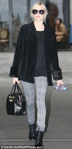 Pretty in plaid: The 32-year-old showed off her trim figure in a pair of on-trend monochrome trousers