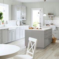 IKEA A large grey country kitchen with a lot of drawers, wall cabinets and a kitchen island. Bodbyn Kitchen Grey, Grey Kitchens, White Kitchen Cabinets, Home Kitchens, Wall Cabinets, Kitchen Island, Grey Cabinets, Kitchen Sinks, Bodbyn Grey