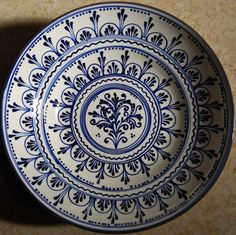 30 cm diameter ceramic bowl with Szasz design.Lovely blue and white!