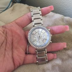 NY&C silver watch Never worn. Brand new. Silver with diamonds around it. One size fits all. NY Collection Accessories Watches
