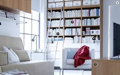 Ikea Besta Bookcase combination and birch effect finish with vara drawer fronts in white.