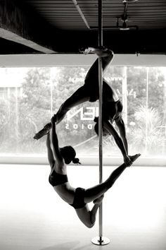 Wow... I was trying to figure out how the bottom girl was hanging on, but she's being held up by the top girl. That must feel like flying!!!! Gotta take this picture with your choice of your pole friend that has the strongest knee hold!!!!