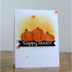 handmade Fall card: Happy Harvest ... trio of die cut pumpkins ... one layer ... scattering of sequins ... orange & olive with black and white ... like it!