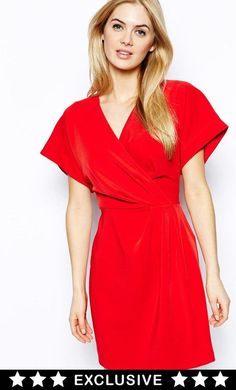 Made from a woven poly-blend. V-neckline. Wrap front with tie waist. Wide-cut sleeves. Zip back faste...