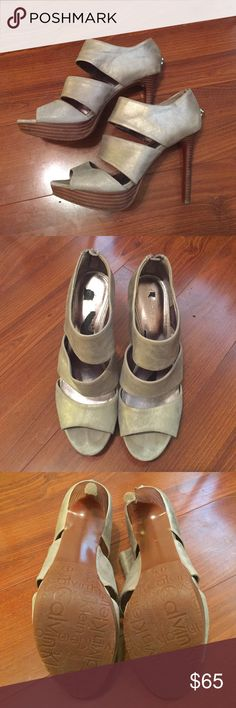 Calvin Klein Silver Strappy Heels Calvin Klein silver pumps. Can be dressed up or dressed down and perfect for the holidays. Very little wear. Only damage is from sole inserts that had a sticky back, which caused some of the sole material to peel off when removed. Calvin Klein Shoes Heels