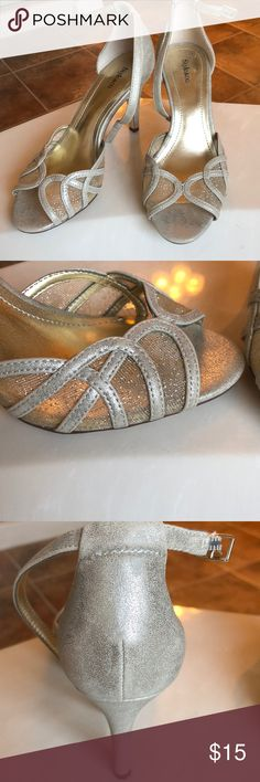 Metallic heels Beautiful silver/gold heels. The front has a mesh design with gold flakes in it. Worn to an event once. Too small of a size for me. Very cool peep toe design! Style & Co Shoes Heels