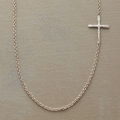 "STERLING SILVER LINKED CROSS NECKLACE -- Superfine links uphold a hand hammered cross set to one side of Rebecca Lankford 's small sterling cross necklace. Handcrafted in USA with a spring ring clasp. Cross is approx. 1/2""L"