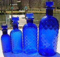 Set of 4 different size diamond quilted poisons with POISON stoppers.