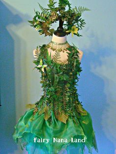 (Faux) Moss, ferns and foliage cover a corset top (bust sz. 40) the perfect compliment to a layered organza faerie skirt and magnificent moss and