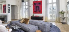 Designer, Rodolphe Parente mixes the clients contemporary art and modern furniture in this Trocadero apartment in Paris.