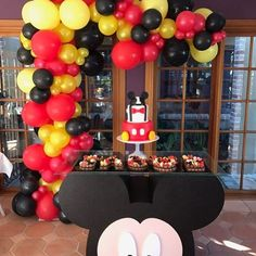 Image may contain: indoor Mickey Mouse Theme Party, Mickey Mouse Birthday Decorations, Mickey Mouse Centerpiece, Mickey 1st Birthdays, Fiesta Mickey Mouse, Mickey Mouse Balloons, Mickey Mouse Clubhouse Birthday Party, Mickey Mouse 1st Birthday, Mickey Mouse Table