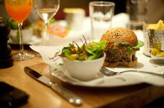 Serves dishes that match the name — lobster, lobster roll or burger, all with chips and each one costing a minimum of $31.