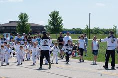 Leyla helping to lead the pre-k students during the parade. She is happy to show off her new black belt uniform. #huntley #kma #fujifilm #omgimshootingjpegs #memorialday