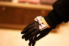 Black Leather Gloves with Bow Ties & a Black Sweater.