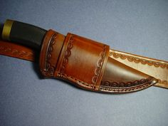 Custom hand tooled leather knife sheath for a buck 692 Vanguard    8.5""